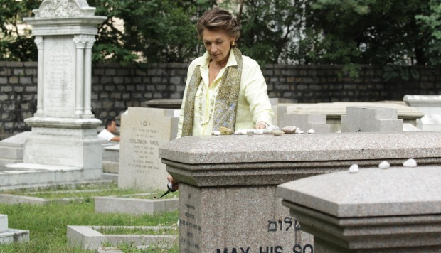 Judy Green places stones of remembrance on Lawrence and Horace Kadoorie's sarcophagi at the Jewish Cemetery in Happy Valley. Photos: Dickson Lee; The Hong Kong Heritage Project; Nora Tam