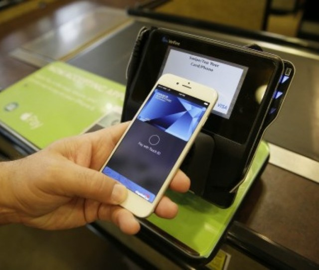 An Apple Executive Demonstrates The Apple Pay Mobile Payment System Which Is Coming To Hong Kong Soon Photo Ap