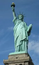The Statue of Liberty welcomes the stranger.