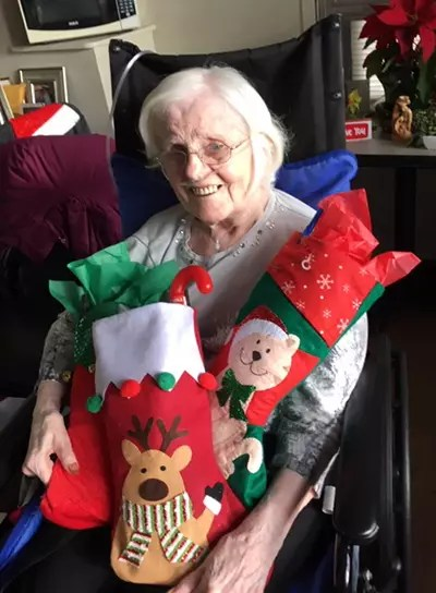 Sr. Mary Caulfield with stocking for the Sisters.