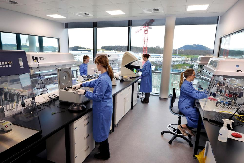 Scientists at work at LifeArc, formerly Medical Research Council Technology, at BioQuarter Edinburgh, pictured in 2018. Picture: Scottish Enterprise/Colin Hattersley
