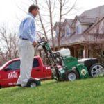 man using grass cutter