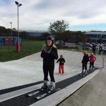 Young girl on ski lift during ASN snowsport session
