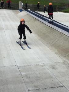 Young skier coming down ski slope at ASN snowsports session