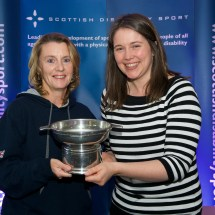 Karen Ross receiving the Angus Trophy on behalf of Gordon Reid