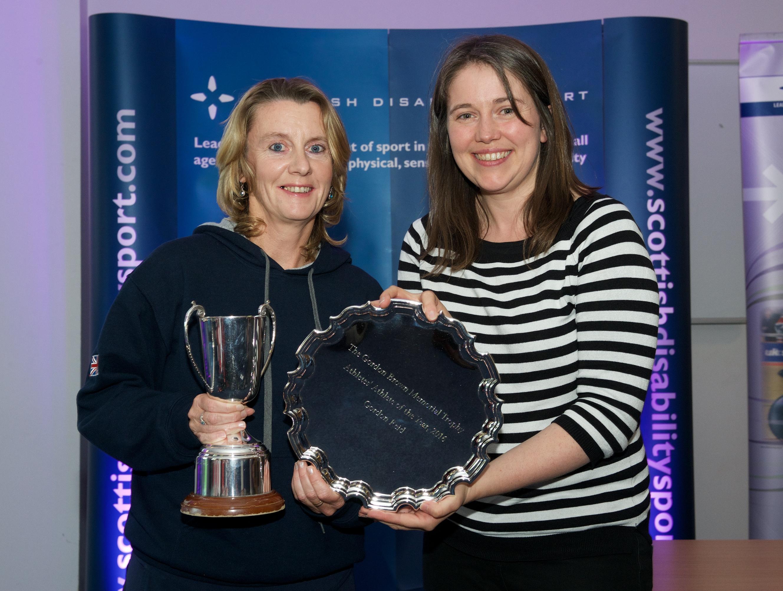 Karen Ross receiving the Gordon Brown trophy on behalf of Gordon Reid