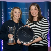 Karen Ross receiving the Gordon Brown trophy on behalf of Gordon Reid