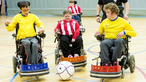 Powerchair football game in progress