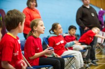 Girl preparing to throw boccia ball