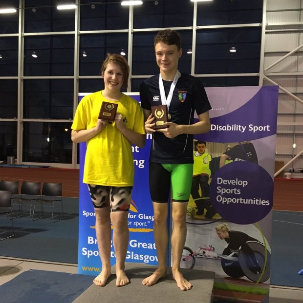 Tammy Need and Jack Milne receiving their Best Female & Male Awards at the Championships