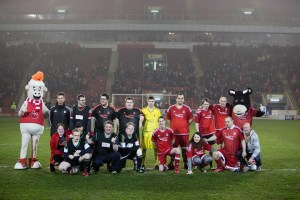 Group photo of team on pitch