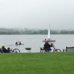 Cyclists in front of the water