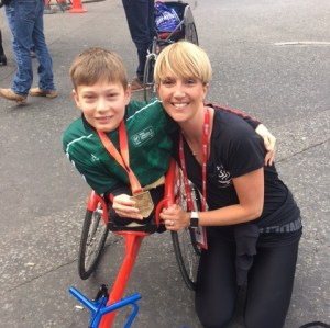 Callum Sloan with coach Pamela Robson after the marathon