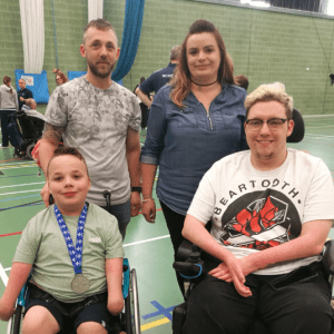 Tyler with his parents and Kieran Steer