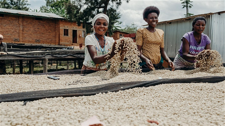 Two women with Rwandan coffee beans