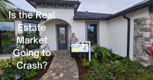 Scott Rivelli Standing in front of a Oaktree model home by Pulte asking if the Real Estate market is Going to Crash