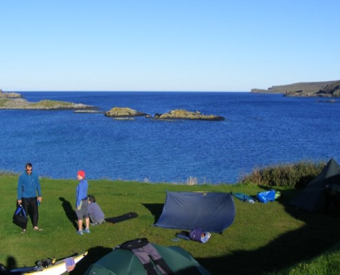 Campers with tents at Scourie caravan and Camping Site