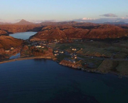 Scourie Caravan and camping site viewed from above Scourie Bay