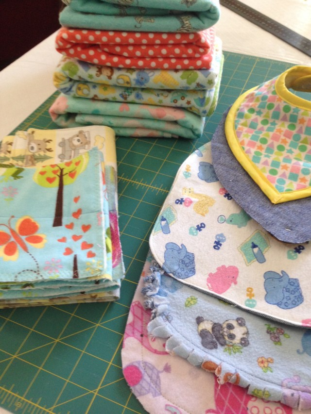 Blankets, bibs, and burp cloths