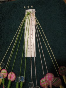Bobbin lace set-up for a net ground with 6 sets of bobbins