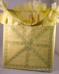 Back of the tissue bag with a quilt block-style pattern of washi tape