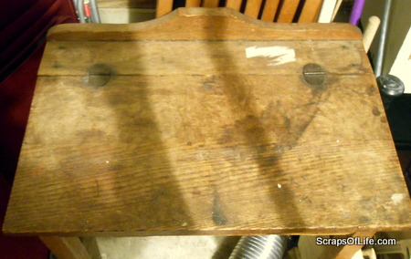 Top of the antique child's school desk, scarred and stained