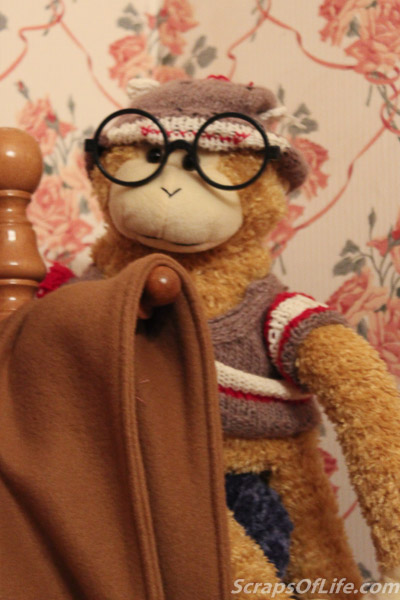 The Original George. And, yes, he's a monkey wearing a sock monkey hat and cardigan. Like you do.