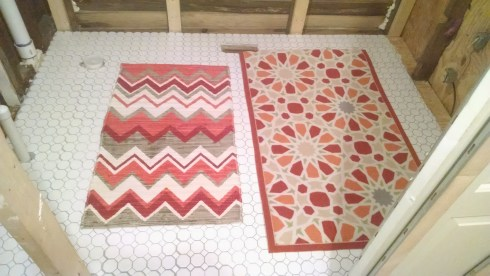 The perfect rug would be the size of the one on the right with the pattern of the one on the left. But perfection is overrated.