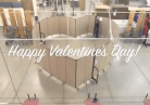 Happy Valentine's Day over Screenflex Room Dividers formed into a heart shape.
