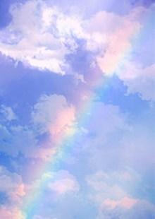 A striking rainbow against a cloudy sky