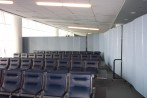 Private passenger waiting room in an airport created with Screenflex Portable Room Dividers.
