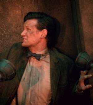 Attack of the toilet plunger! Matt Smith as the Doctor. Image © BBC