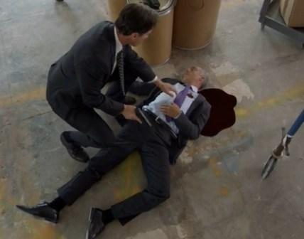 Peter (TIm DeKay) appears guilty of Pratt's (Titus Welliver) murder (Image © USA Network)