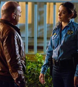 "Pictured L-R: Dean Norris as James ""Big Jim"" Rennie and Natalie Martinez as Deputy Linda. Photo: Michael Tackett/©2013 CBS"