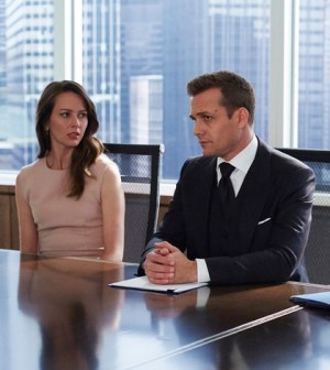 """SUITS -- """"No Puedo Hacerlo"""" Episode 504 -- Pictured: (l-r) Amy Acker as Esther, Gabriel Mact as Harvey Specter, Meghan Markle as Rachel Zane -- (Photo by: Shane Mahood/USA Network)"""