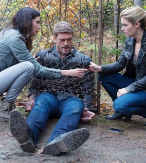 Pictured: (l-r) Laura Mennell as Dr. Charlotte Cross, Adam Copeland as Dwight Hendrickson, Emily Rose as Audrey Parker -- (Photo by: Michael Tompkins/Haven 5 Productions/Syfy)