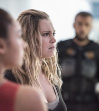 "The 100 -- ""God Complex"" Pictured (L-R): Lindsey Morgan as Raven, Eliza Taylor as Clarke, and Jarod Joseph as Miller -- Credit: Dean Buscher/The CW"