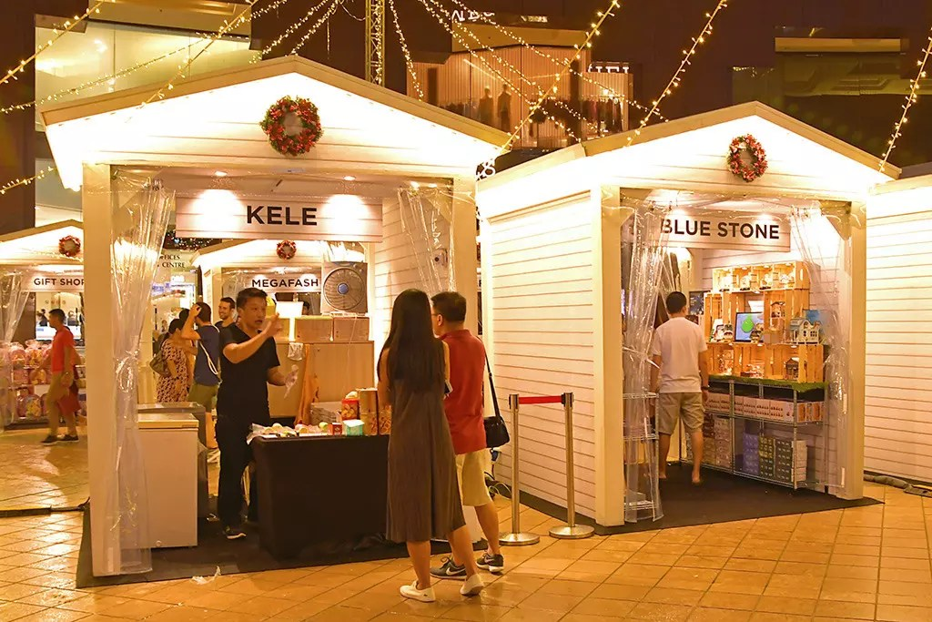 Orchard Road's First Christmas Village at night.