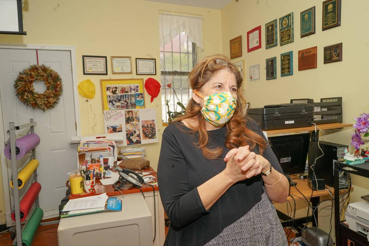 Maria Collier, director of the Cypress Hills Child Care Corporation, stands in front of her desk.