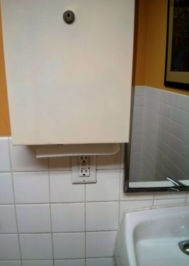 Old MultiFold towel cabinet on top of GFCI outlet