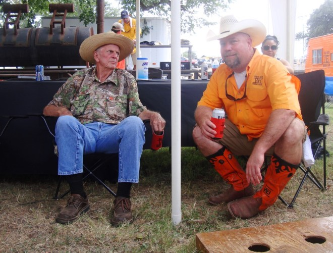 An Elderly Gentleman Relaxes In The Shade With Kyle Walton, pitboss of Waco Boys Cooking Team