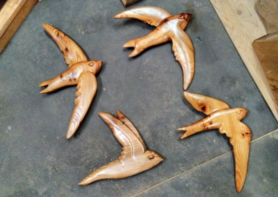 Flying swifts wall carvings