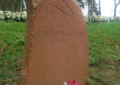 Hand-carved headstone memorial sandstone with pike motif, Gordonstoun School