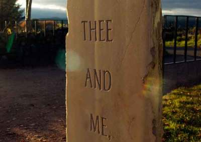Hand-carved lettering on sandstone garden sculpture