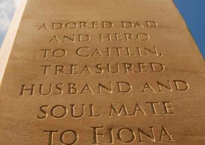 Hand-carved Clashach sandstone headstone memorial for Scottish rally champion Jimmy Girvan