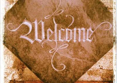 hand-carved lettering slate sign Welcome
