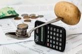 potato, calculator, spoon, and penny