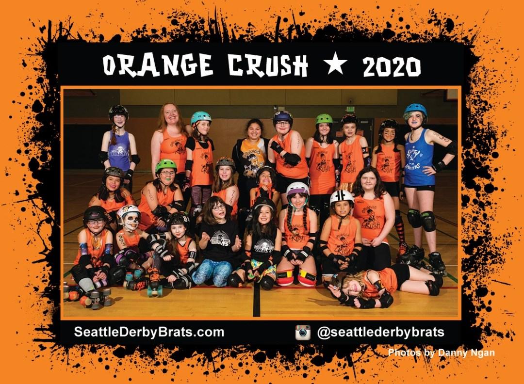 Orange Crush 2020 Team Photo featuring the junior roller derby team in their orange jerseys, safety gear, and helmets that showcase their personality.