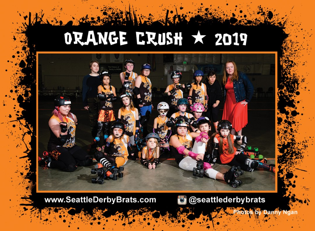 Orange Crush 2020 Team Photo featuring the junior roller derby team in their yellow jerseys, safety gear, and helmets that showcase their personality.