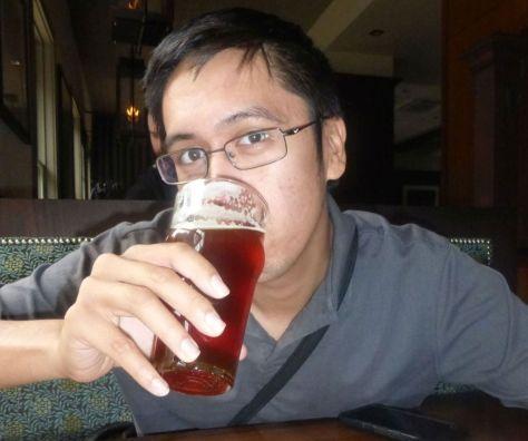 My husband tasting my beer.